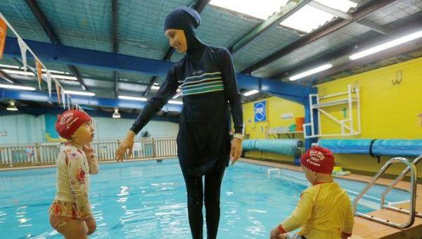 20cba88b2972d Australian muslim swimming instructor Fadila Chafic wears her full-length ' burkini' swimsuit during