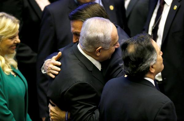 Brazilian President Jair Bolsonaro and Israeli Prime Minister Benjamin Netanyahu embrace at Bolsonaro's inauguration.