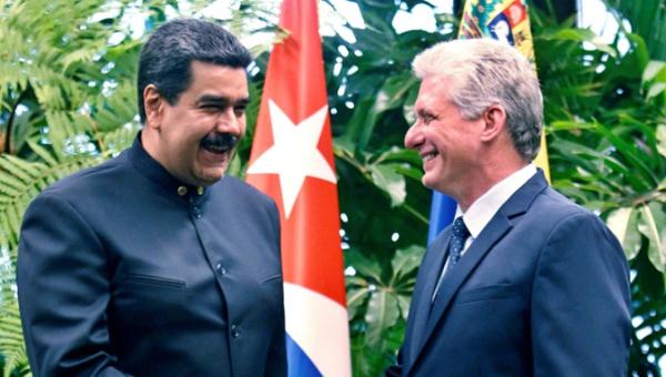 Cuba will be in solidarity with Venezuela despite U.S. sanctions. Venezuelan President Nicolas Maduro with Cuban President Miguel Diaz-Canal