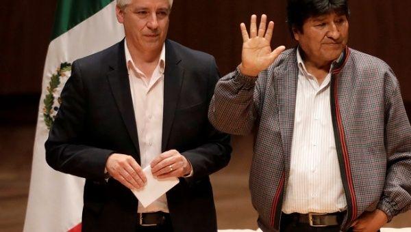Bolivia's former President Evo Morales gestures next to former Vice President Alvaro Garcia Linares, in Mexico City, Mexico November 26, 2019.