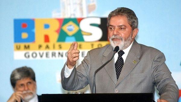 Lula de Silva, then President of Brazil, delivers speech in front of large crowd in Brasilia.