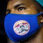 Citizen wears a mask with the image of Commander Hugo Chavez, Caracas, Venezuela, Nov. 29, 2020.