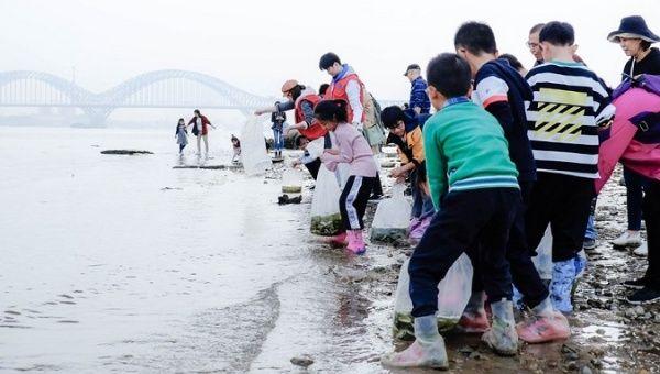Citizens release fry voluntarily into the Yangtze River in Nanjing, China, Nov. 15, 2019.