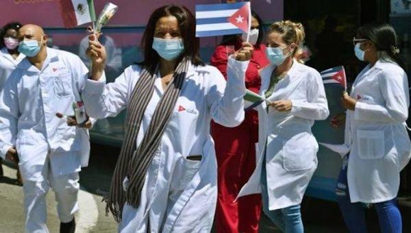 Doctors wave a Cuban flag in Havana, Cuba, January 22, 2021.