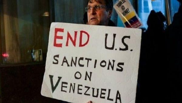 A man protests US sanctions on Venezuela, U.S., Apr. 23, 2021.