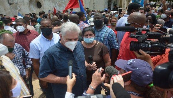Miguel Diaz-Canel talks to people who were protesting in San Antonio de los Baños, Artemisa, Cuba, Jul 11, 2021.