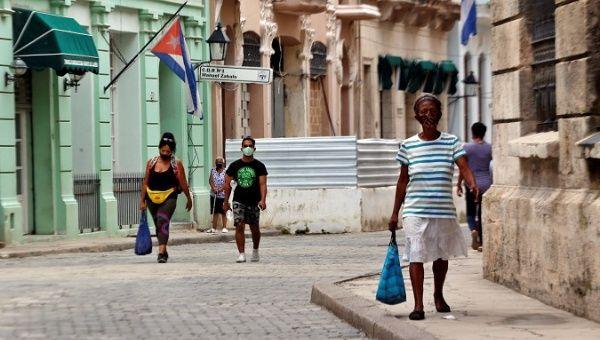 People walk on a street in Havana, Cuba, Aug. 7, 2021.